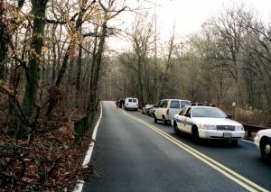 Leakin Park, 1999, road WSW several cars, Med Examiner in red scrubs